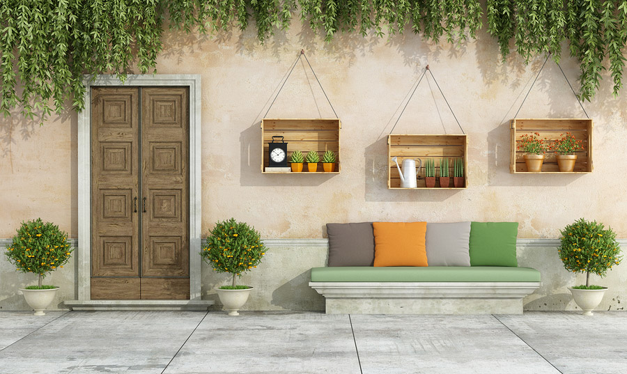 Country house with old doorstone bench colorful cushion
